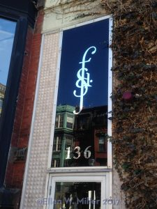 window showing the SFD logo on Newbury St.