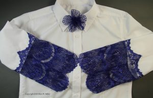 Blue lace replaces the lower sleeve on a RTW white shirt. A lace flower is pinned to the collar
