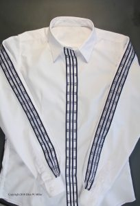 Organza ribbon sewn to the sleeves and front placket of a RTW white shirt
