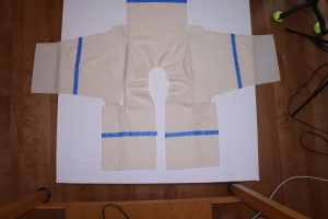The white wool jacket laid flat.