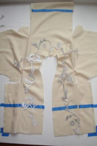 The wool jacket with the postive stencil pieces laid all over.