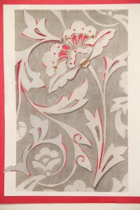 A grey and white stencil version of the Victorian wallpaper.
