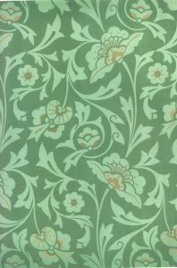 An intricate green Victorian wallpaper pattern.