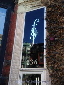 window showing the SFD logo on Newbury St.