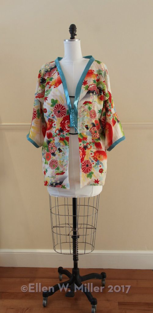 Alice's completed kimono with light teal collar and sleeve bands and 4-strand flat braid closure