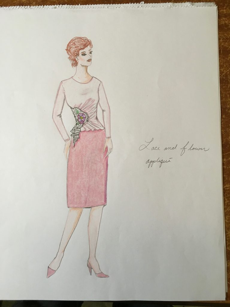 Sketch showing a long sleeve blouse with lace and applique on one side